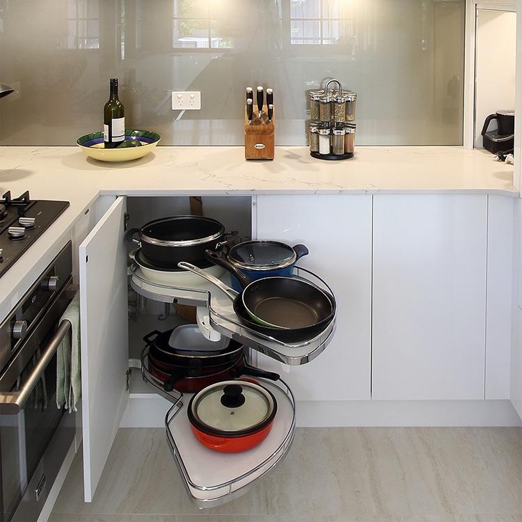 Kitchen cabinet pot rack storage solution