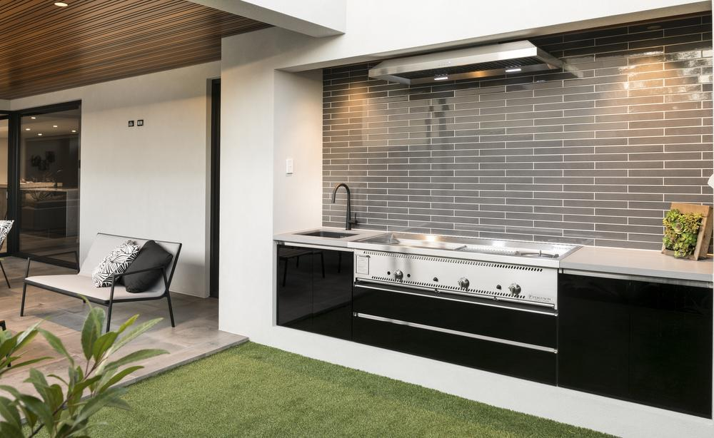 outdoor kitchen with black cabinetry