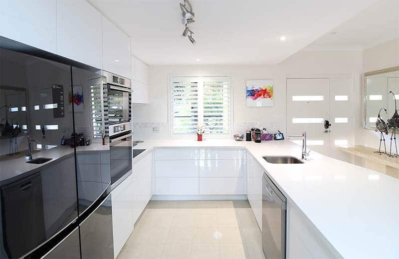 kitchen with white benchtops