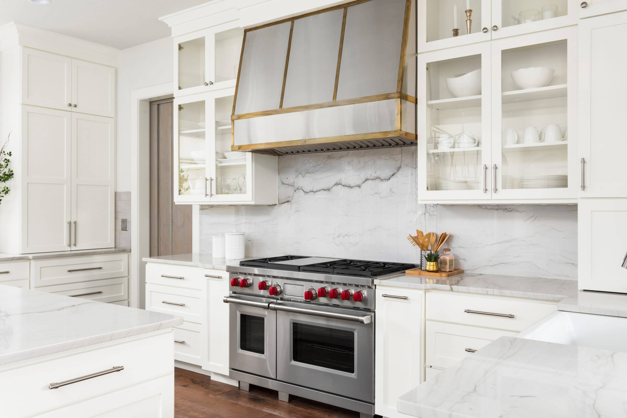 white kitchen detail in new luxury home oven range hood and countertops
