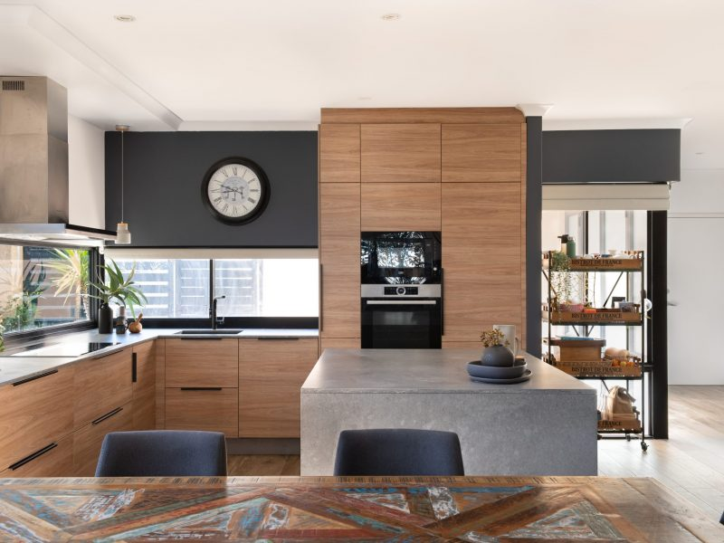 kitchen-renovation-marble-bench-top-brown-cupboards